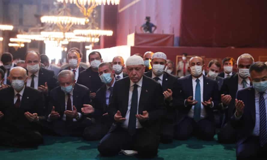 Erdoğan (centre) with his senior ministers. The president began the service with a recital from the Qur'an.