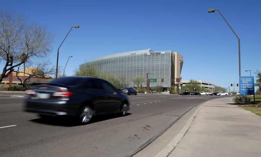 A car passes the location where a woman pedestrian was struck and killed by an Uber self-driving sport utility vehicle in Tempe, Arizona, on Monday.