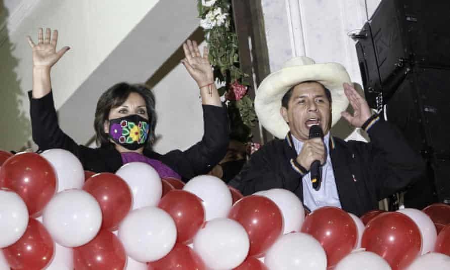 Pedro Castillo and vice-president elect Dina Boluarte celebrate after their election win was confirmed.