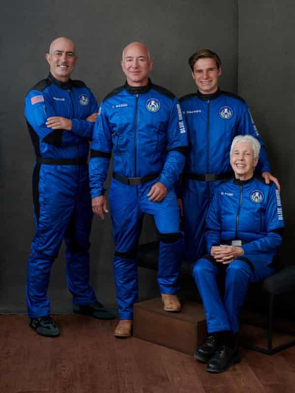 Jeff Bezos, Mark Bezos, pioneering female aviator Wally Funk and recent high school graduate Oliver Daemen pose ahead of their scheduled flight.