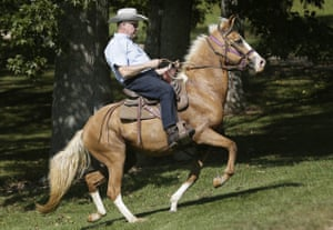 Former Alabama chief justice Roy Moore rides in on a horse to vote in Gallant, Alabama.