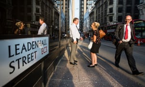 Workers in Leadenhall Street, City of London, the UK's financial hub.