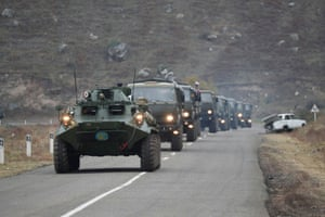 Lachin, Azerbaijan  Military vehicles of the Russian peacekeeping forces drive along a road in the region of Nagorno-Karabakh