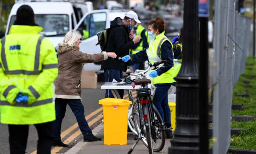 People are at a Covid-19 surge-testing site in Clapham, south London