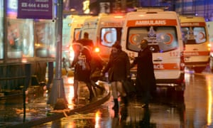 People are escorted away as ambulances queue up at the scene of the attack in Istanbul.