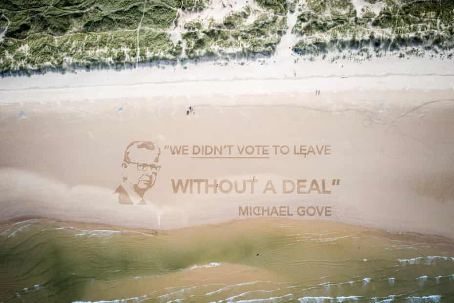 """Photo issued by Led By Donkeys of a sand installation on Redcar beach in North Yorkshire which depicts Michael Gove next to his quote """"We didn't vote to leave without a deal."""""""