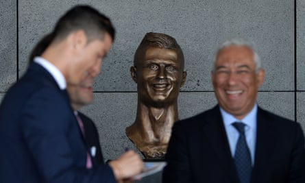Cristiano Ronaldo unveiling his bust at Madeira airport last year.