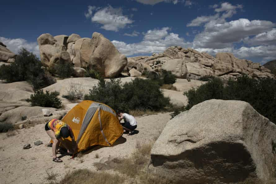 Marta Jerebets and Arthur Pettit pitch their tent on a campground at Joshua Tree national park on 19 May.