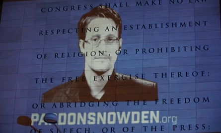 An image of Edward Snowden is projected on to the side of the Newseum, in Washington DC.