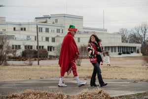 The empty Twin Rivers Regional Medical Center is visible as Gaetanna and Chad McCarthy try to raise donations to pay for cancer treatment for Margie Wilson on December 21 in Kennett, Missouri.