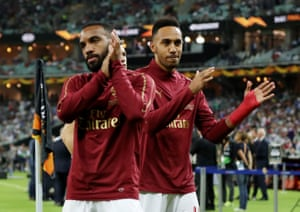 Arsenal's Alexandre Lacazette (left) and Pierre-Emerick Aubameyang applaud the fans during the warm up.