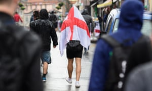 An England fan wearing the flag of St George in Lens, northern France.