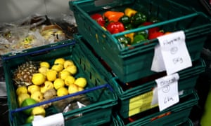 Fruit and vegetables are packed into crates at the FareShare food redistribution centre in Deptford, London.