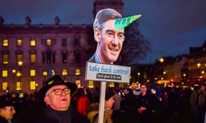 An anti-Brexit protester with a placard of Jacob Rees-Mogg, London, January 2019