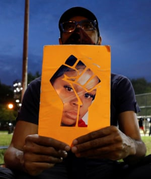 A demonstrator holds an image depicting Breonna Taylor during a protest in New York.