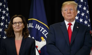 Donald Trump stands with incoming CIA director Gina Haspel during her swearing-in ceremony at CIA headquarters on 21 May.