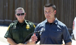 Acting secretary of homeland security Kevin McAleenan, right, speaks on the US-Mexico border in Arizona.