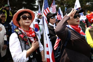 Conservative South Korean protesters demonstrate against the summit in Paju, South Korea