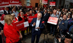 Jeremy Corbyn, the leader of Britain's opposition Labour Party, speaks next to Joy Squires, Labour's local candidate, during a campaign stop in Worcester,