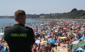 A member of the ambulance service looks out from Bournemouth Pier