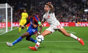 Trent Alexander-Arnold tussles with Wilfried Zaha.