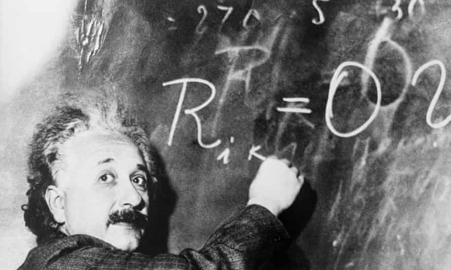 Albert Einstein writes a complicated equation on a blackboard. He is at the California Institute of Technology for a lecture being given by Swedish astronomer Dr. Gustave Stromberg.