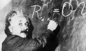 Einstein writes on blackboard