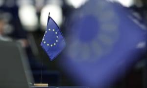 An EU flag on a desk in the European parliament.
