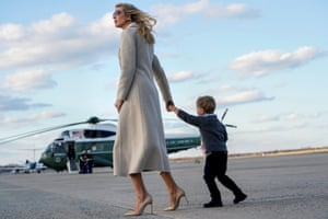 Donald Trump's daughter Ivanka and her son Theodore walk from Air Force One at Joint Base Andrews.