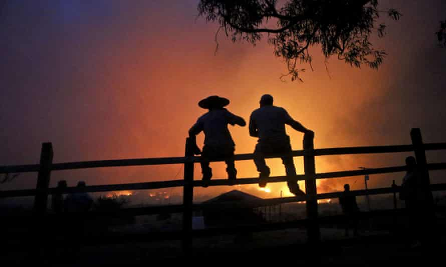 Residents watch the forest burn in Portezuelo on 29 January.