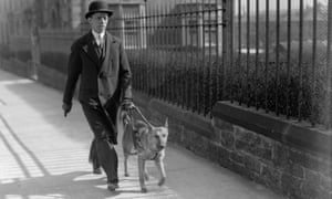 MP Andrew Gilzean is guided through the streets of Edinburgh by his Alsatian guide dog Lady, April 1935.