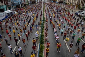 Devotees observe social distancing as they hear mass outside Quiapo church to celebrate the Feast of the Black Nazarene