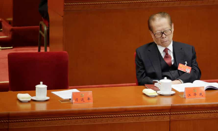 Former Chinese president Jiang Zemin takes a nap as Xi Jinping delivers his speech to the 19th national nongress of the Communist party in Beijing.