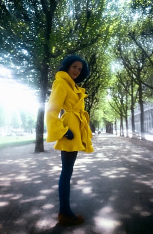 A model in Paris wearing a ruffled yellow coat and blue tights for Kenzo for JAP, also in 1971