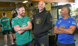 Tyson Fury and his trainers Andy Lee (left) and SugarHill Steward at the Any Time Fitness gym in Henderson.