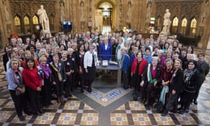 Theresa May and women from both houses of parliament in 2018