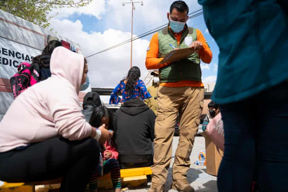 Families wait inside a processing center in Ciudad Juárez as they are interviewed near the Paso del Norte international bridge.
