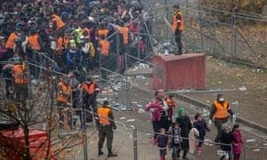 Refugees wait at the border to Austria in Sentilj, Slovenia.