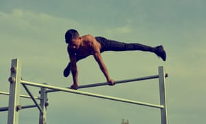 Callisthenics champion Jay Chris using Steel Warriors in Langdon Park, Tower Hamlets, east London.