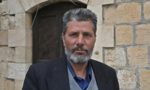 Fadel Tamimi, an imam, claims his home has been raided about 20 times.