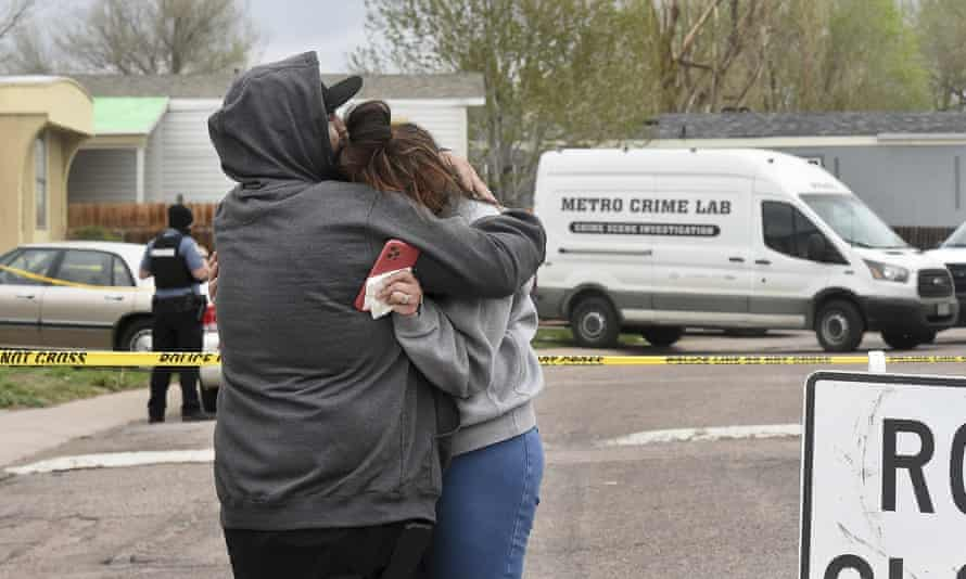 Relatives comfort each other after a mass shooting in Colorado Springs, in which a man killed his girlfriend and five others.