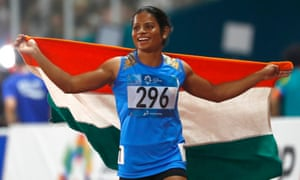 Dutee Chand celebrates after her second place finish in the women's 100m final during the athletics competition at the 18th Asian Games in 2018