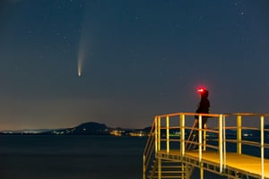 Neowise appears before sunrise over Balatonmáriafürdő, in Hungary, on 14 July. The comet passed closest to the sun on 3 July and its closest approach to Earth will occur on 23 July