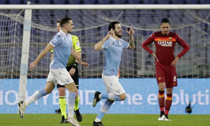 Luis Alberto (centre) celebrates after scoring Lazio's third goal in the Rome derby.