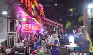 A busy night market in Wuhan, which has reported no asymptomatic Covid-19 cases after widespread testing.
