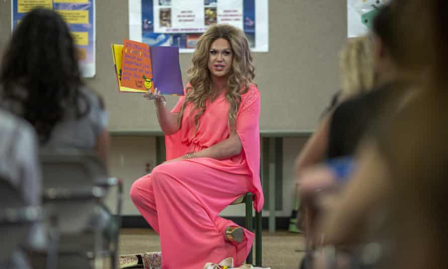 Drag queen Pickle reads from a book during the Drag Queen Story Hour program at the West Valley Regional Branch Library on 26 July in Los Angeles, California.