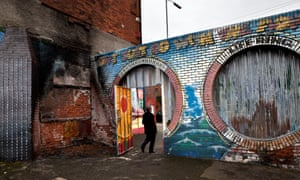 """Belfast's """"peace walls"""" are almost 20ft high, built to separate nationalists and unionists."""