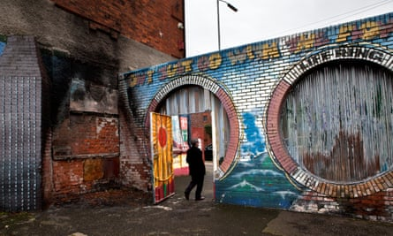"Belfast's ""peace walls"" are almost 20ft high, built to separate nationalists and unionists."