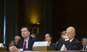 FBI director James Comey (left), and National Intelligence Director James Clapper, testify before the Senate hearing on Russian intelligence activities.