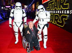 Kenny Baker is given a helping hand by stormtroopers